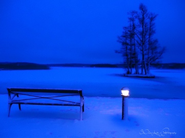 blue morning over the frozen lake